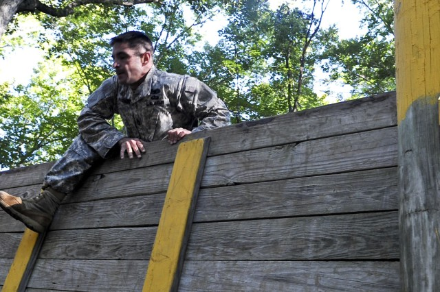 Sgt. 1st Class Kevin McDaniel, a Soldier assigned to the U.S. Maneuver Support Center of Excellence, clears a wall at the 2012 Advanced Individual Training Platoon Sergeant of the Year competition at Fort Eustis, Va., Sept. 25, 2012. McDaniel is an AIT platoon sergeant at Fort Benning, Ga.