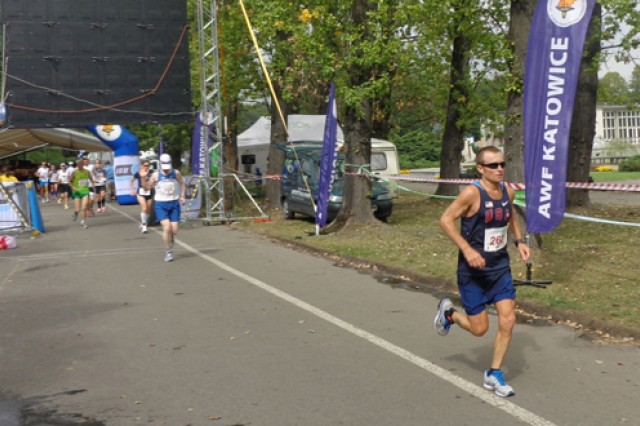 Master Sgt. Mike Morton, leads the pack of runners at the International Association of Ultrarunners 9th Annual 24-Hour World and 18th European Championships, Sept. 8, 2012, in Katowice, Poland.  Morton, a U.S. Army Special Operations Command liaison officer, took first place and also broke the U.S. 24-hour record by running 172.457 miles.