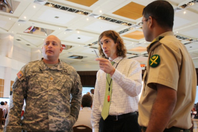 U.S. Army Corps of Engineers Geographer Justin Pummell, center, speaks Maj. Rollin Heassler, Contingency Command Post, U.S. Army Pacific, and Maj. Mohammad Shaqi Kawjar, Bangladesh Armed Forces Division, Headquarters during the second day of table top exercises at the third annual Pacific Resilience Disaster Response Exercise and Exchange 2012 in Dhaka, Bangladesh last week.