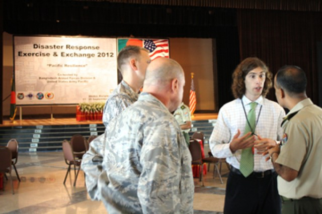U.S. Army Corps of Engineers Geographer Justin Pummell welcomes participants and introduces speakers during the third annual Pacific Resilience Disaster Response Exercise and Exchange 2012 in Dhaka, Bangladesh last week. Pummell develops, leads, plans and executes Humanitarian Assistance and Disaster Management projects and exercises such as the DREE throughout Asia that enhance readiness and response to all hazards in accordance with international and national emergency response and preparedness standards.