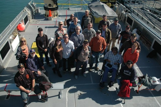 "Crew members from the ""John A. B. Dillard, Jr."" vessel take a group photo with members of the Oakland-based Disabled American Veterans, Chapter 7, and the VA Martinez Community Living Center before embarking on a tour of the San Francisco Bay Sept. 20."