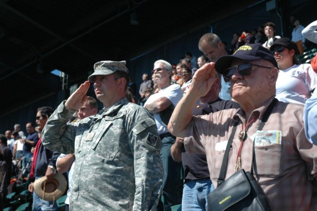 Maj. Ryan Thompson, left, chief of the U.S. Army Corps of Engineers San Francisco District Hydro Survey Section, salutes alongside Mickey Ganitch, age 92, a Navy veteran and Pearl Harbor survivor, during the playing of the National Anthem before the San Francisco Giants game Sept. 20 at AT&T Park.