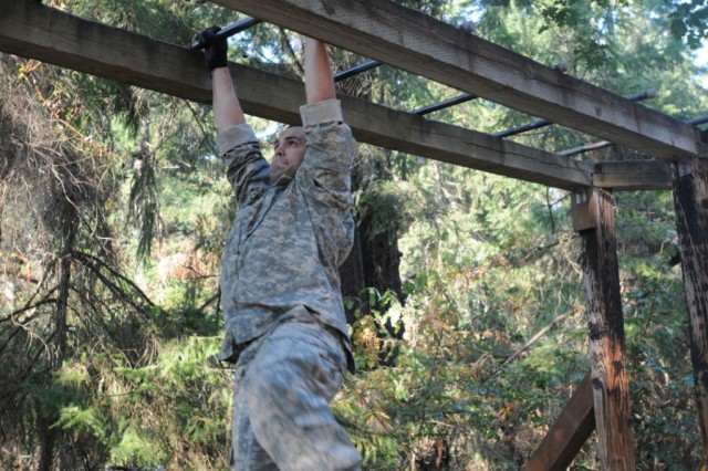 Staff Sgt. Alexander Folsom, with Madigan Healthcare Syste, Joint Base Lewis-McChord, Wash., negotiates a confidence course obstacle during the 2012 Top Medic Team Competition at JBLM. Folsom earned a spot to the two-man medic team that will represent the Western Regional Command at the Army Medical Department's Best Medic Competition in November.