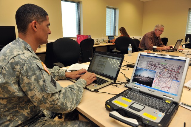 U.S. Army Corps of Engineers, Europe District Forward Engineer Support Team (FEST) member Captain Richards, 7th Civil Support Command and 589 FEST unit, analyzes data from the route reconnaissance after working with Italian security forces during the training.