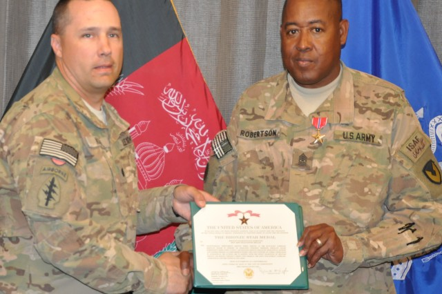 Lt. Col. Peter J. Koch, AFSBn-Bagram, 401st Army Field Support Brigade commander, gives Sgt. Maj. Donald R. Robertson, AFSBn-BAF, 401st AFSB, senior noncommissioned officer, the Bronze Star Medal citation during an awards ceremony at battalion headquarters Sept. 21. Robertson was awarded the Bronze Star Medal, the Afghanistan Campaign Medal and the NATO medal.