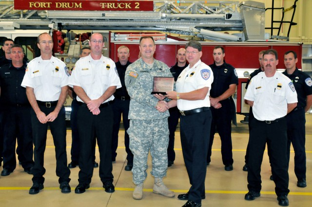 Members of the Fort Drum Fire and Emergency Services Division pose for a photo last week with Col. Gary A. Rosenberg (center), Fort Drum garrison commander, who presented the department with the Director of Army Safety Composite Risk Management Award.