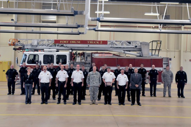 Members of the Fort Drum Fire and Emergency Services Division pose for a photo Sept. 18 with Col. Gary A. Rosenberg (center), Fort Drum garrison commander.
