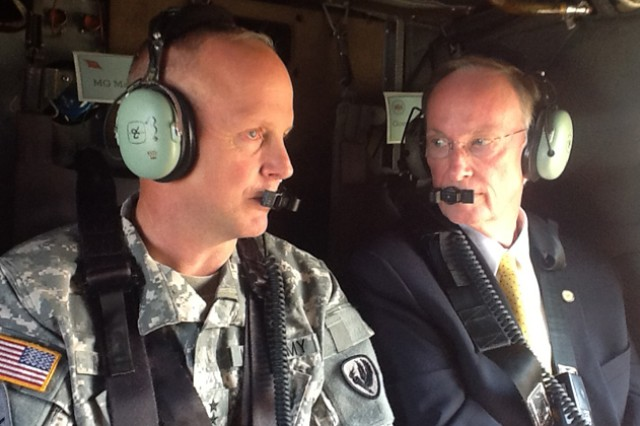 Maj. Gen. Kevin W. Mangum, USAACE and Fort Rucker commanding general, speaks with Alabama Gov. Robert Bentley during an aerial tour of Fort Rucker in a UH-60 Black Hawk helicopter during the governor's visit to the post Sept. 20.