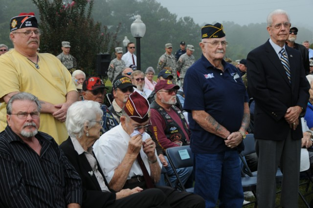 "Veterans stand to be honored for their service to the nation while the ""Armed Forces Service Medley"" is played.  Arthur J. Osepchook, center, retired master sergeant, overwhelmed, sits to remember lost comrades."