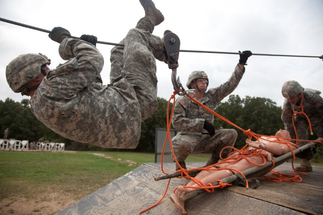 U.S. Military Police Soldiers conduct warrior tasks and drills during the 2012 Military Police Warfighter Competition on Fort Leonard Wood, Missouri Sept. 16, 2012. The Military Police Competition is an annual event that tests an MP's physical, mental and tactical endurance.