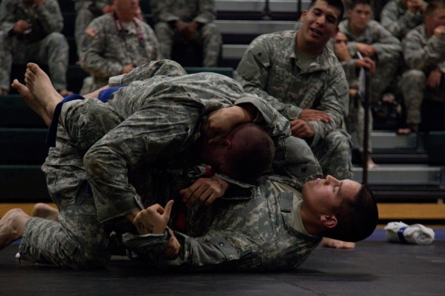 U.S. Military Police Soldiers conduct a combatives tournament during the 2012 Military Police Warfighter Competition on Fort Leonard Wood, Missouri Sept. 16, 2012. The Military Police Competition is an annual event that tests an MP's physical, mental and tactical endurance. )U.S. Army photo by Spc. Aaron Whitecotton)