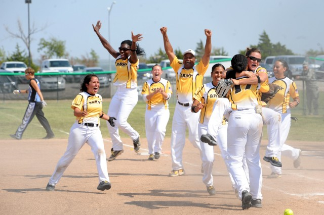 The All-Army women's softball team jumps for joy after winning the Armed Forces Championship Sept. 20, 2012, at Fort Sill, Okla. The team dedicated their win to Sgt. Brian Walker, who was killed May 13, 2012, in Afghanistan.