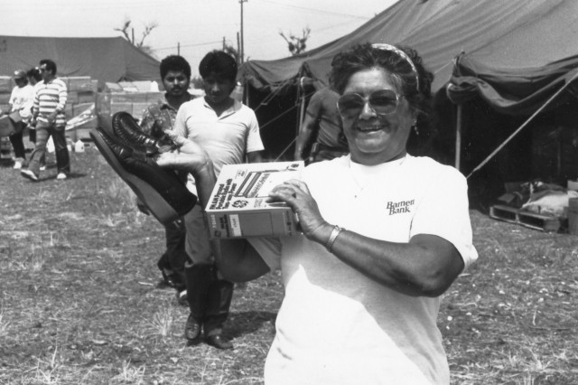 A Floridian receives a pair of donated shoes at an AMC distribution center following Hurricane Andrew. (U.S. Army photo)
