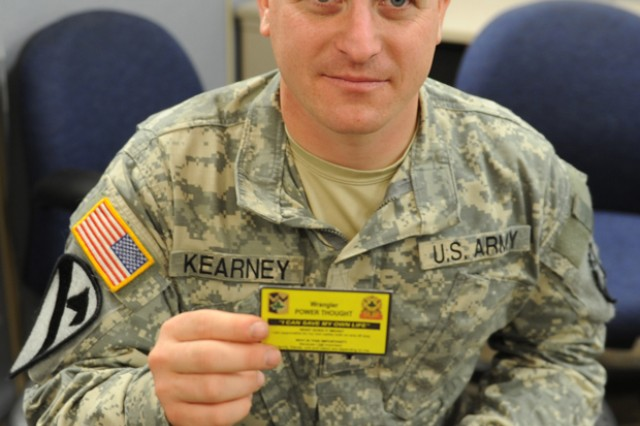 Spc. Robert Kearney, 4th Sustainment Brigade, 13th Sustainment Command (Expeditionary) at Fort Hood, Texas, holds the Buddy Card issued to all Wrangler Brigade troops. The card reminds Soldiers to watch out for each other and be a buddy to their comrades. Kearney has already taken advantage of help offered at Fort Hood. (U.S. Army photo by Heather Graham-Ashley, III Corps and Fort Hood Public Affairs)
