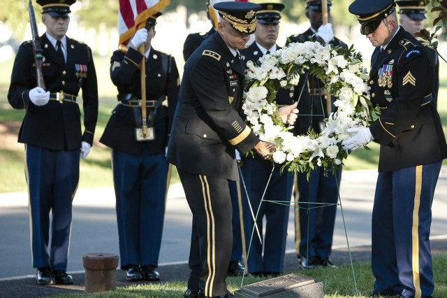 Maj. Gen. David E. Quantock (left), provost marshal general of the Army, commanding general United States Army Criminal Investigation Command and Army Corrections Command, and Sgt. Joseph Wilson, representing all Military Police during the ceremony, place a wreath on the plaque laid in memory of Military Police who have lost their lives. Photo By Rachel Larue.