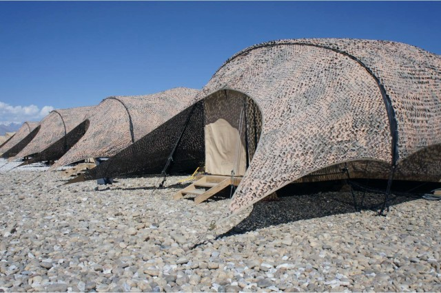 Among the energy-efficient technologies being demonstrated at the Task Force Muleskinner base camp, Bagram Airfield, Afghanistan, are solar shades to keep Force Provider shelters cool.