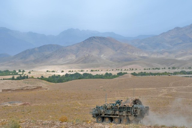 A Task Force Arrowhead Stryker vehicle drives to an over-watch position in the Mizan district, southern Afghanistan for operation Kalak Hode 5, Sept. 5, 2012.