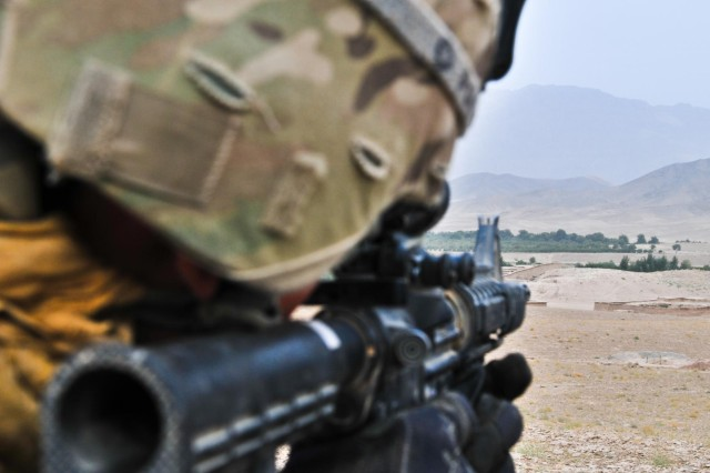 First Lt. Dillon Kareive, an officer with 426th Civil Affairs Battalion, Combined Task Force Arrowhead stares down his sights while providing security for Afghan National Army soldiers during operation Kalak Hode 5 in the Mizan district of southern Afghanistan, Sept. 5, 2012.