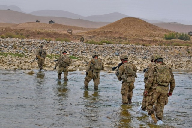 Task Force Arrowhead Soldiers make their way back across the Arghandab River in the Mizan district of southern Afghanistan under the watchful eyes of their fellow Soldiers, Sept. 5, 2012. These Soldiers helped provide over-watch for the Afghan National Army during operation Kalak Hode 5.