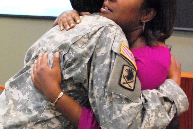Barbara Davis, Davenport, Iowa, shares a hug with a Soldier following her presentation in Building 350 Sept. 27 in support of the Army Sustainment Command's suicide prevention 'stand down' day. Davis's daughter, Damika, committed suicide Aug. 20, 2009 at age 29. (Photo by Jon Connor, ASC Public Affairs)