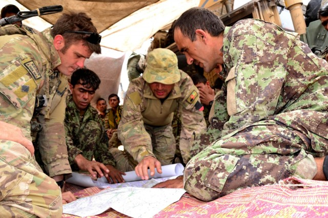 Australian Lt. Tim Glover, Mobile Advisory Group commander, Mentoring Team Charlie, 3rd Royal Australian Regiment Task Group, discusses a clearance plan with an Afghan National Army engineer officer, Sept. 6, 2012.