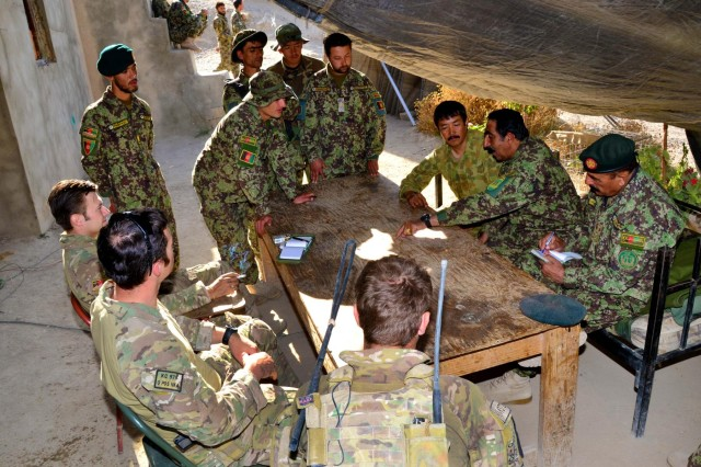 Afghan National Army Lt. Col. Abdul Ghafoor, 3rd Kandak commander, briefs his subordinates and coalition partners on clearance operations during a mission in Khas Uruzgan, Afghanistan, Sept. 10, 2012.