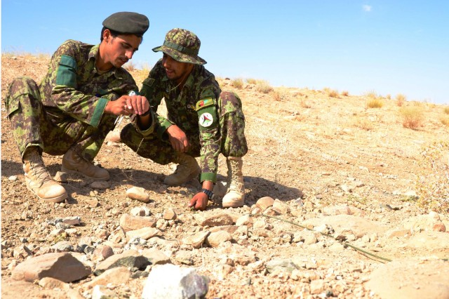 Afghan National Army trainees supervise peers in the placement of demolitions charges and check timers during the Explosives Hazard Reduction Instructor Course at the counter improvised explosives device range in Tarin Kot, Afghanistan, Aug. 16, 2012.