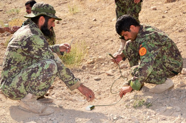 Afghan National Army trainees supervise peers in the placement of demolitions charges during the Explosives Hazard Reduction Instructor Course at the counter improvised explosives device range in Tarin Kot, Afghanistan, Aug. 16, 2012.