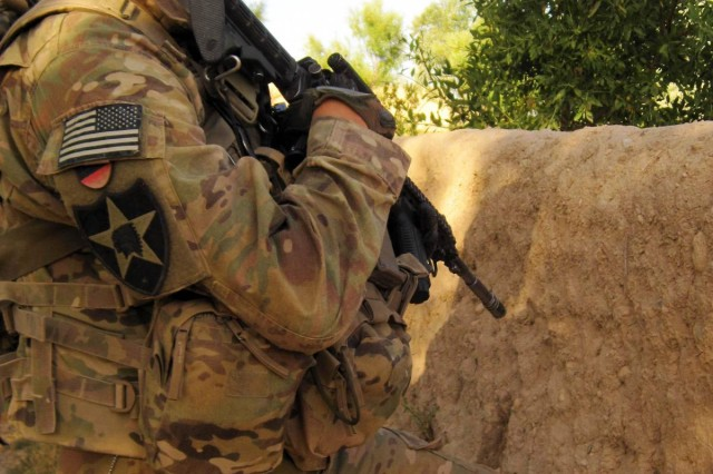 Pfc. Robert Snodgrass, medic for 2nd Platoon, Alpha Troop, 1-14th Cavalry, pulls security behind a mud wall during a patrol near Patrol Base Khyber, Afghanistan, June 24, 2012. Snodgrass has been an Army medic for 15 months now and is halfway through his tour overseas.
