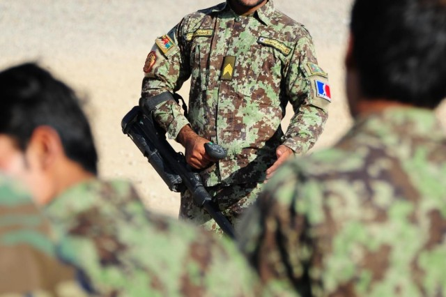 Sgt. Wakil from the Afghan National Army instructs members of the Afghan National Army and the Afghan National Police in the use of a metal detector at Patrol Base Musaza'i, Afghanistan, July 30 2012. (Australian army photo by Cpl. Hamish Paterson, 1st Joint Public Affairs Unit)