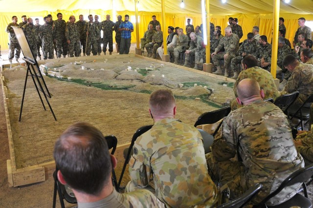 Soldiers with Afghan National Army, 4th Brigade Headquarters, brief the operation plan to their coalition partners at a combined arms rehearsal, Aug. 14, 2012.