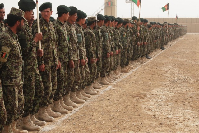 Afghan National Army soldiers wait for their graduation ceremony to begin at the Regional Military Training Center-Kandahar at Camp Hero, Afghanistan, Sept. 13, 2012. The center graduated more than 1,000 soldiers at the ceremony from both the basic training course and the officer basic course.