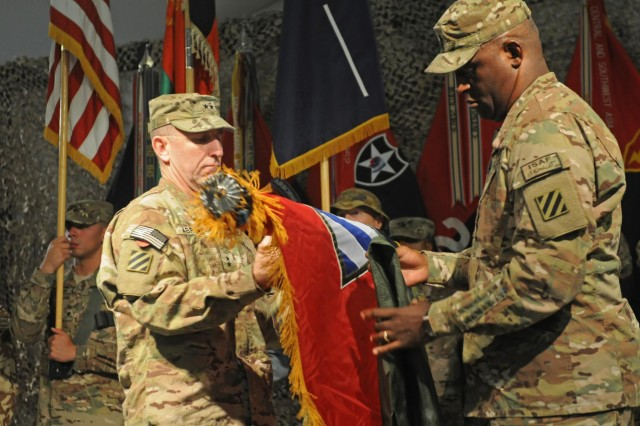 "U.S. Army Maj. Gen. Robert ""Abe"" Abrams, 3rd Infantry Division commanding general and incoming Regional Command (South) commanding general, and 3rd Infantry Division Command Sgt. Maj. Edd Watson, incoming Regional Command (South) command sergeant major, uncase the Combined Joint Task Force-3 colors during the Regional Command (South) Transfer of Authority Ceremony at Kandahar Airfield, Sept. 2, 2012. The 3rd Infantry Division assumed command of the region from the 82nd Airborne Division during the ceremony."
