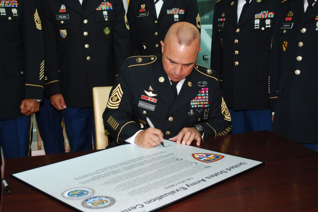 Command Sgt. Maj. Allen Fritzsching signs the NCO Creed proclamation to reaffirm his support of the duties of the Noncommissioned Officer Sept. 28 in support of Operation Solemn Promise.