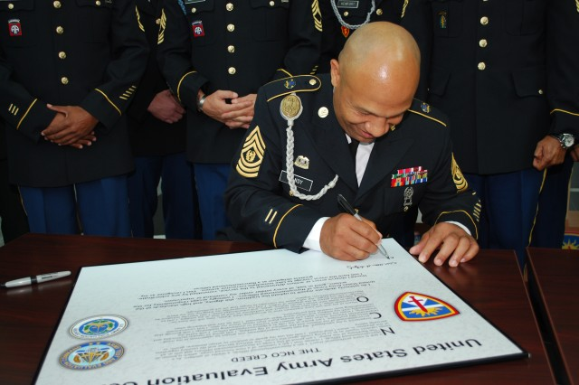 Command Sgt. Maj. Carlton Handy signs the NCO Creed proclamation to reaffirm his support of the duties of the Noncommissioned Officer Sept. 28 in support of Operation Solemn Promise.