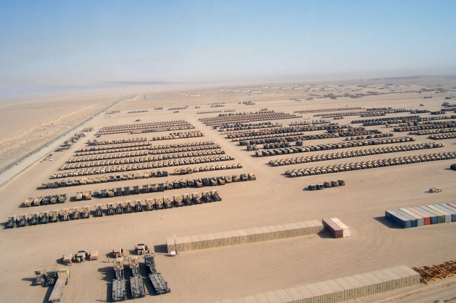 Aerial shot of equipment storage in Southwest Asia. AMC has the daunting task of repairing and moving enormous amounts of materiel to include: 60,000 to 80,000 containers; 50,000 vehicles; and upwards of 3 million different pieces of equipment. U.S. Army photo.