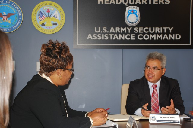 Gokhan Tokus, from the NATO Support Agency, speaks with the Security Assistance Command's deputy director for EUCOM/AFRICOM, Jacqueline Williams, during a case management review at USASAC's headquarters.