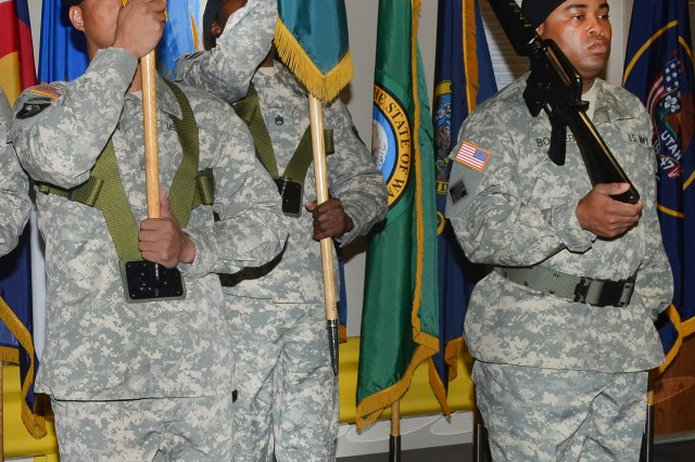 The Army Sustainment Command colors are moved into the position vacated by the Installation Management Command colors during the Directorate of Logistics Transfer Ceremony at Rock Island Arsenal Oct. 1. The ceremony marked the transfer of 73 Directorates of Logistics worldwide from IMCOM to ASC.