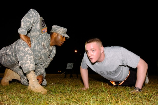 Sgt. Nicholas Johnson, U.S. Forces Korea Soldier of the Year, finishes the pushup portion of the Army Physical Fitness Test during the 6th Annual Department of the Army Best Warrior Competition, Oct. 3, 2011, at Fort Lee, Va.