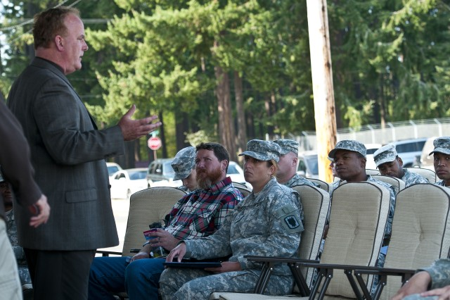 Michael Healey, the executive officer for the National Center for Telehealth and Technology's Joint Base Lewis-McChord, Wash., site talks to a group of Soldiers Sept. 26 about a variety of mobile phone applications his organization offers to help treat post-traumatic stress. Healey's presentation was part of a weeklong event at JBLM that the Army is referring to as a terrain walk, which the base held in conjunction with Army Suicide Prevention Week 2012 to match up Soldiers with the services that can help them or their fellow Soldiers in times of need.