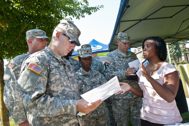 Tasha Peniche, a counselor for the Army Career and Alumni Program on Joint Base Lewis-McChord, Wash., talks to a group of Soldiers Sept. 26 during a weeklong event at JBLM that the Army is referring to as a terrain walk. The base held the walk in conjunction with Army Suicide Prevention Week 2012 to match up Soldiers with the services that can help them or their fellow Soldiers in times of need.