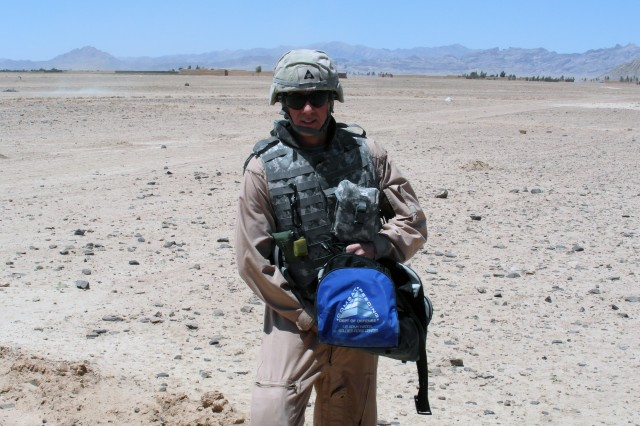 Steve Belmore holds a Combat Feeding Directorate bag just outside of Forward Operating Base Pasab, Afghanistan. Belmore returned to Natick Soldier Research, Development and Engineering Center in mid August after spending 18 months in Afghanistan with the Army Corps of Engineers.