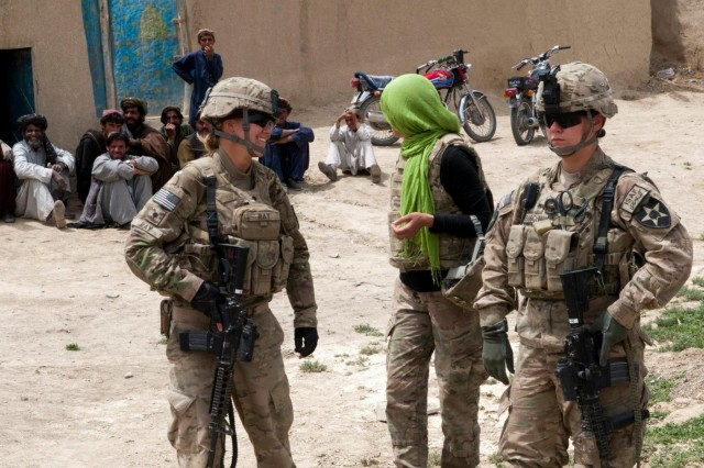Spc. Heather Ray and Pfc. Jacqueline Buschman, Battle Company, 5th Battalion 20th Infantry Regiment, Task Force 1-14 Cavalry Regiment, and their female interpreter, return from a meeting with some Afghan women in the village of Akhvond Qalay, Afghanistan, May 8, 2012. Women account for nearly half the population of Afghanistan and have considerable influence on Afghan society so it is important for female engagement teams, such as the one Ray and Buschman make up, to develop trust-based and enduring relationships with the Afghan women they encounter on patrols.