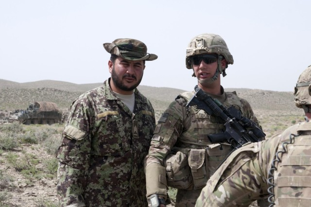 First Sgt. Talib Hussain (left), Weapons Company first sergeant, 1st Kandak, 2nd Brigade, 205th Corps, Afghan National Army, Shinkai district, discusses the upcoming patrol with 2nd Lt. Matthew Domenech, platoon leader, 3rd Platoon, Battle Company, 5th Battalion 20th Infantry Regiment, Task Force 1st Squadron, 14th Cavalry Regiment. Good partnerships are important to the welfare of Afghanistan at every level, including the platoon level.
