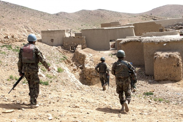 Afghan National Army soldiers from 1st Kandak, 2nd Brigade, 205th Corps, Shinkai district, move into the village of Sowkray, May 7, 2012. The patrol, one of several that week, was planned and directed almost completely from start to finish by 1/2/205th ANA soldiers who took charge and led the way.