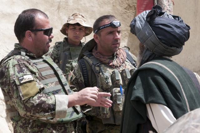 Capt. Sayed Baba Mansory (left), Officer-in-Charge, 1st Kandak, 2nd Brigade, 205th Corps, Afghan National Army, Shamulzai district and Weapons Company Executive Officer, Lt. Muhammed Nabi, 1/2/205 Corps, ANA, Shinkai district, talk with a village elder about the security situation in Sowkray, Afghanistan, May 7, 2012.