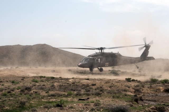 A medevac helicopter takes off following an improvised explosive device strike against an Afghan National Army vehicle, May 8, 2012. Because of the quick response and treatment by medics from 5th Battalion 20th Infantry Regiment, Task Force 1st Squadron 14th Cavalry Regiment, the two ANA soldiers affected lived.