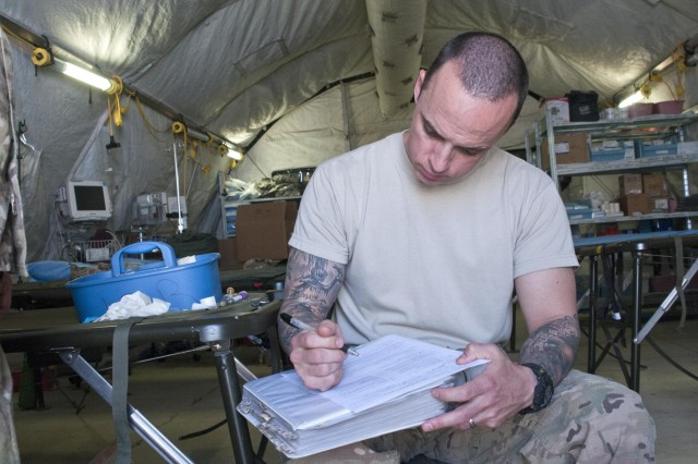 Before being screened for blood donation, 1st Lt. Daniel Brown, Combined Task Force Arrowhead, fills out required paperwork at the Forward Operating Base Lagman Forward Surgical Team site, April 26, 2012. Blood donations in theater are very important in the event a shortage of blood occurs.