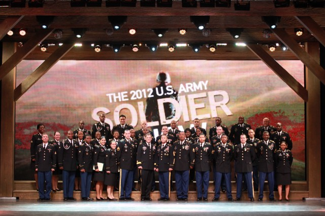 Cast and crew of the U.S. Army Soldier Show pose with Installation Management Command Commanding General LTG Mike Ferriter and CSM Earl Rice following the 2012 season finale at Fort Sam Houston on Sept. 30.