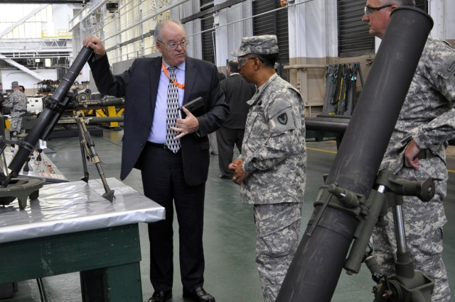 Arsenal Deputy Commander Ed McCarthy, left, briefs Gen. Dennis L. Via about the Arsenal's production of 60mm, 81mm and 120mm mortars, while Arsenal Commander Col. Mark F. Migaleddi observes.